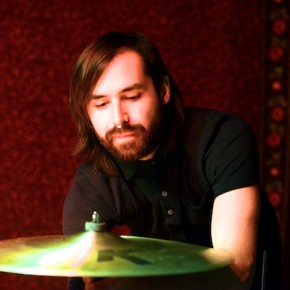Spencer Bray of Night Cadet adjusting his drums