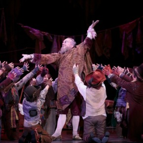 Fatherly Fagin adored by his young followers
