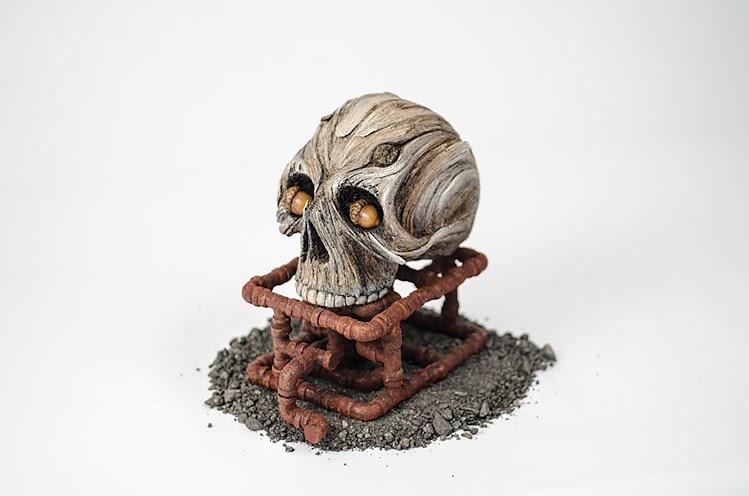 Keystone skull sculpture by Christopher David White memento mori